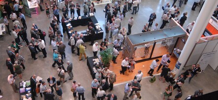 Sponsors viewing exhibits at a trade show